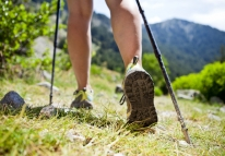 Woman hiking in mountains, adventure and exercising, bushwalking footwear